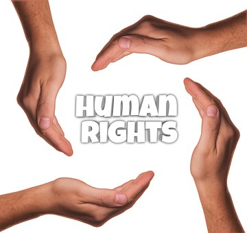 "hands encircling ""human rights"""