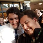 Prime Minister Justin Trudeau takes a selfie with Cody, a CCRW client