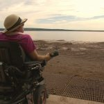 image of woman in wheelchair near the water at the Bay of Fundy